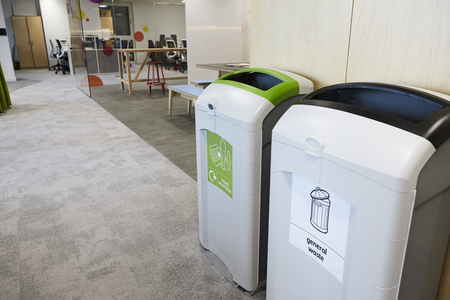Recycling bins in a modern business premises