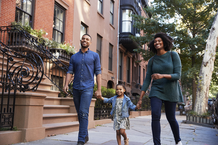 Family taking a walk down the street, close up Standard-Bild