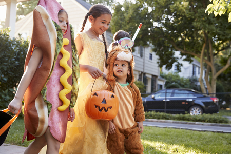 Children Wearing Halloween Costumes For Trick Or Treating Stock Photo