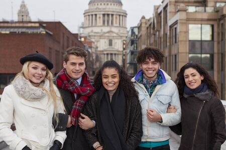 Portrait Of Young Friends Visiting London In Winter Stock Photo