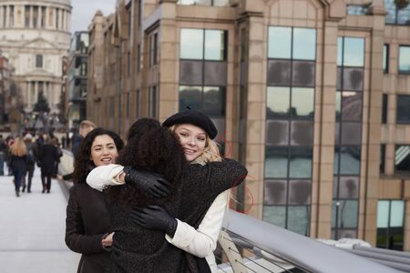 Group Of Female Friends Meeting On Winter Visit To London