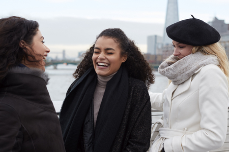 Group Of Young Female Friends Visiting London In Winter Stock Photo
