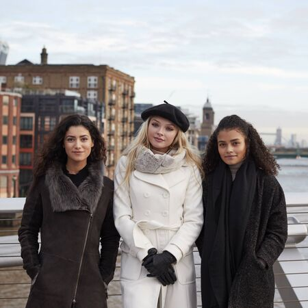 Portrait Of Female Friends Visiting London In Winter