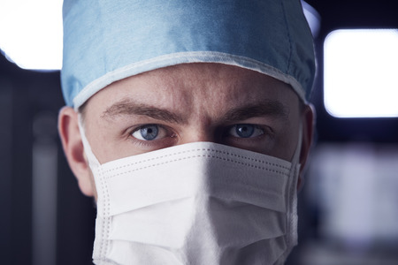 Male healthcare worker in scrubs, head shot Foto de archivo