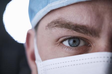 Male healthcare worker in scrubs head shot, close up crop Zdjęcie Seryjne