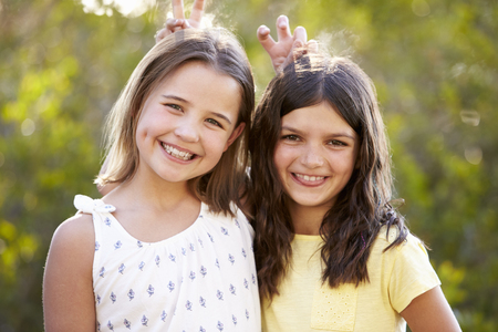 Portrait of two smiling young girls have posing to camera Stock Photo