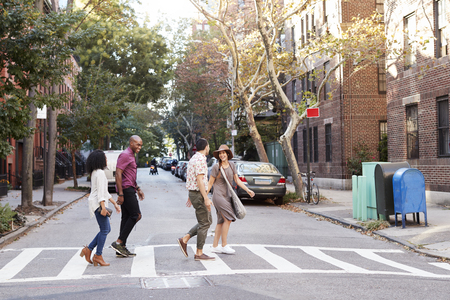 Group Of Friends Crossing Urban Street In New York City Stock Photo