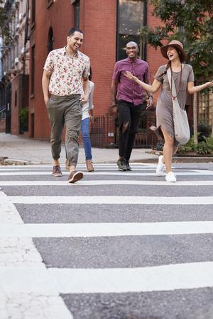 Group Of Friends Crossing Urban Street In New York City Banco de Imagens