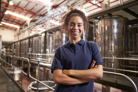 Portrait of young mixed race woman working at a wine factory