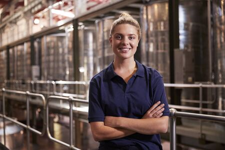 Portrait of a young white woman working at a wine factory Reklamní fotografie