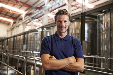 Portrait of a young white man working at a wine factory Stock Photo