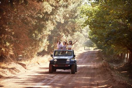 Friends having fun driving in an open top vehicle Stock Photo