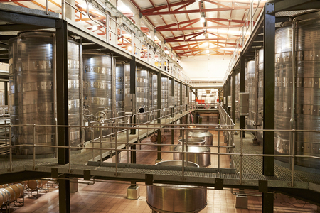 Modern winemaking facility interior, angled view Stok Fotoğraf - 97758397