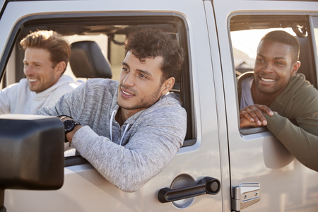 Couple look at each other while driving, rear passenger POV Stock Photo