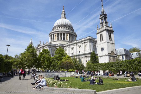 LONDON - MAY, 2017: People relaxing in Festival Gardens by St Paul?s Cathedral, Ludgate Hill, London, EC4.
