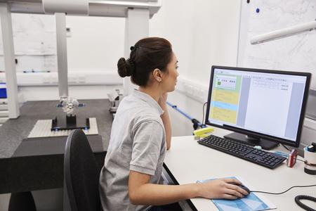 Female Engineer Uses CMM Coordinate Measuring Machine In Factory