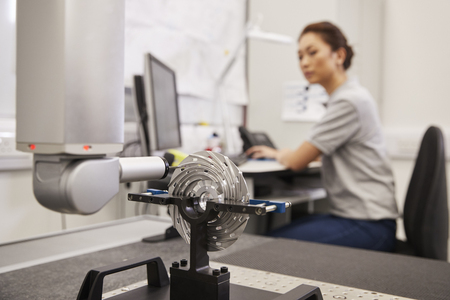 Female Engineer Uses CMM Coordinate Measuring Machine In Factory