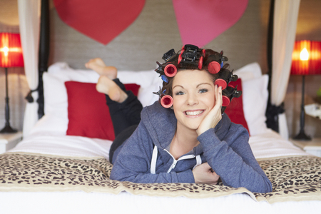 Bride Getting Ready For Wedding With Hair In Curlers