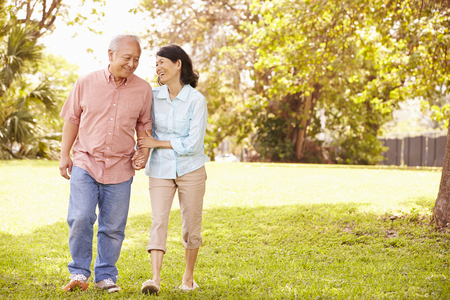 Senior Asian Couple Walking Through Park Together Stok Fotoğraf - 101654894