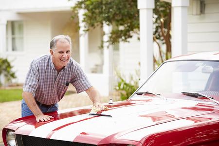 Retired Senior Man Cleaning Restored Car