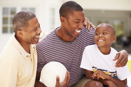 Grandfather With Son And Grandson Playing Volleyball Standard-Bild - 101684061