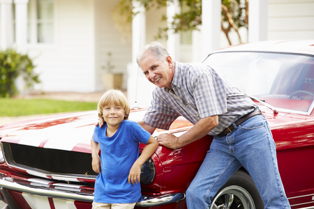 Portrait Of Grandfather And Grandson With Restored Car Stock fotó