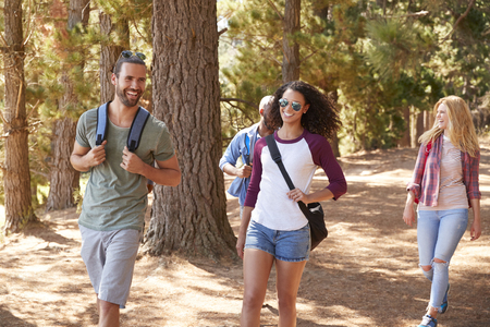 Group Of Young Friends On Hiking Adventure In Countryside Stock Photo