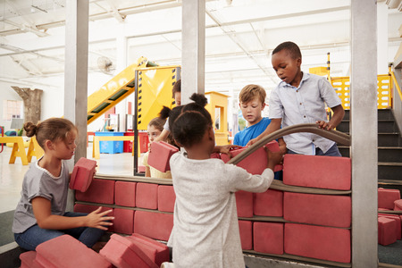 School kids building with toy bricks at a science centre Stock Photo