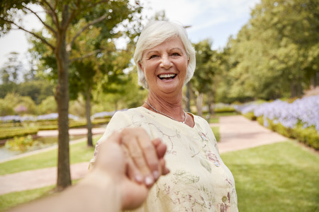 Point Of View Shot Of Senior Couple Walking In Park Together Stock Photo