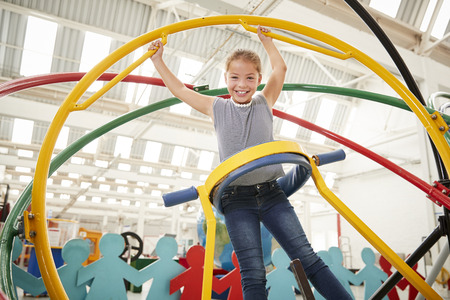 Young white girl having fun using a human gyroscope Stock Photo