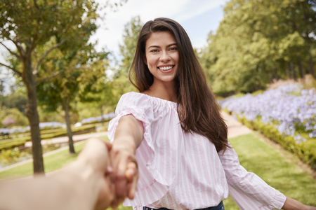 Point Of View Shot Of Romantic Couple Walking In Park Together Stock Photo