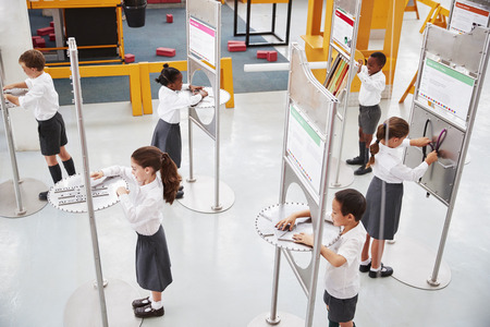 School kids doing science tests at a science centre Stock Photo