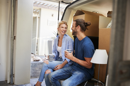 Couple Taking A Break In Back Of Removal Truck On Moving Day 版權商用圖片
