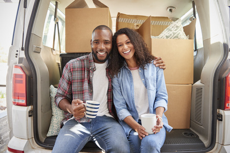 Couple Taking A Break In Back Of Removal Truck On Moving Day Stock fotó