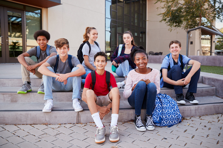 Portrait Of High School Student Group Sitting Outside College Buildings Reklamní fotografie