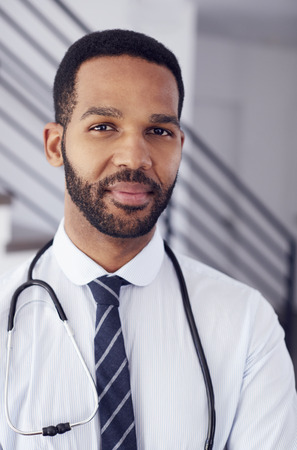 Portrait Of Male Doctor With Stethoscope In Hospital Stock Photo