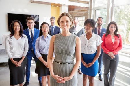 White businesswoman and her business team, group portrait Standard-Bild