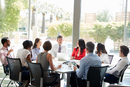 Corporate business team in discussion in a meeting room