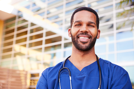Smiling black male healthcare worker, head and shoulders Stock Photo