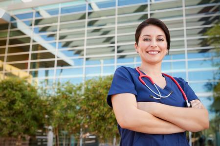 Smiling Hispanic female healthcare worker outdoors, portrait