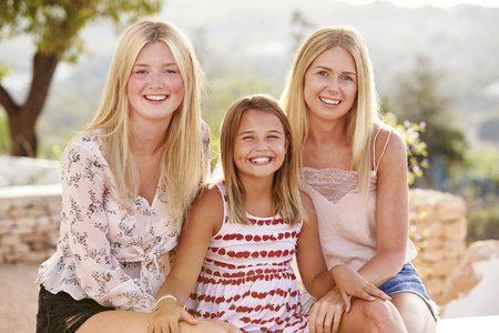 Portrait Of Three Sisters Having Fun On Holiday Together