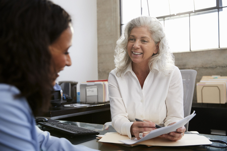 Senior professional woman meeting in office with young woman Stock Photo - 106384670