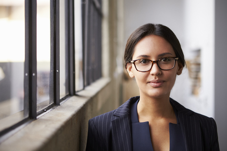 Young mixed race businesswoman wearing glasses, portrait Stock Photo