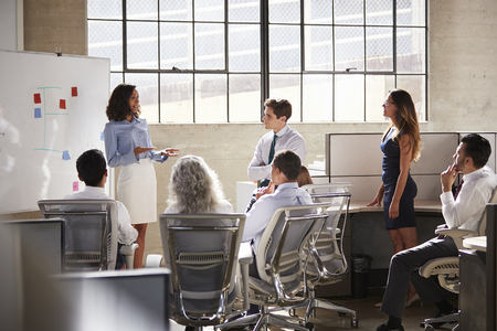 Businesswoman and  colleagues at a brainstorm meeting