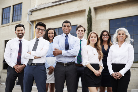 Mixed race businessman and colleagues outdoors, portrait Stock Photo