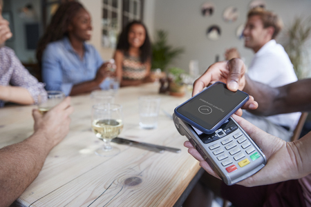 Close Up Of Customer In Restaurant Paying Bill With Contactless Phone App Stock Photo - 109006201