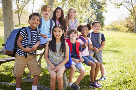 Multi-ethnic group of school kids hanging out on school trip