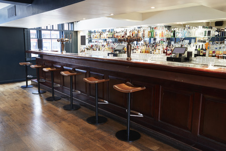 interior of empty bar with stools and counter stock photo picture