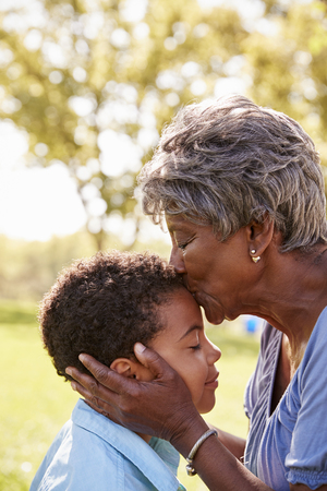 Close Up Of Grandmother Kissing Grandson In Park Standard-Bild - 108652429