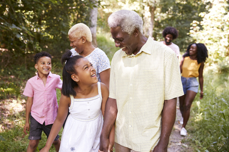 Multi generation black family walking in forest, close up Stock Photo